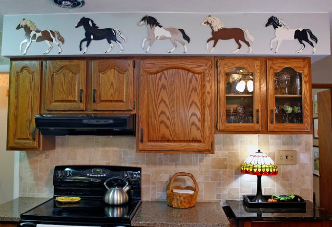 Ann Sheahan was inspired to paint these cut-outs of wild ponies after she saw them in Chincoteague Island, Va.
