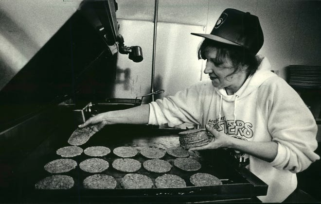 Webb worker Susan Scott kept burgers coming at the free for all  in April 1987.