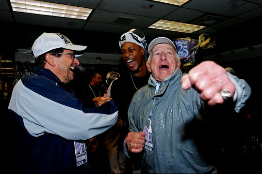 Broadcaster Bob Uecker and owner Mark Attanasio celebrate with Keon Broxton.