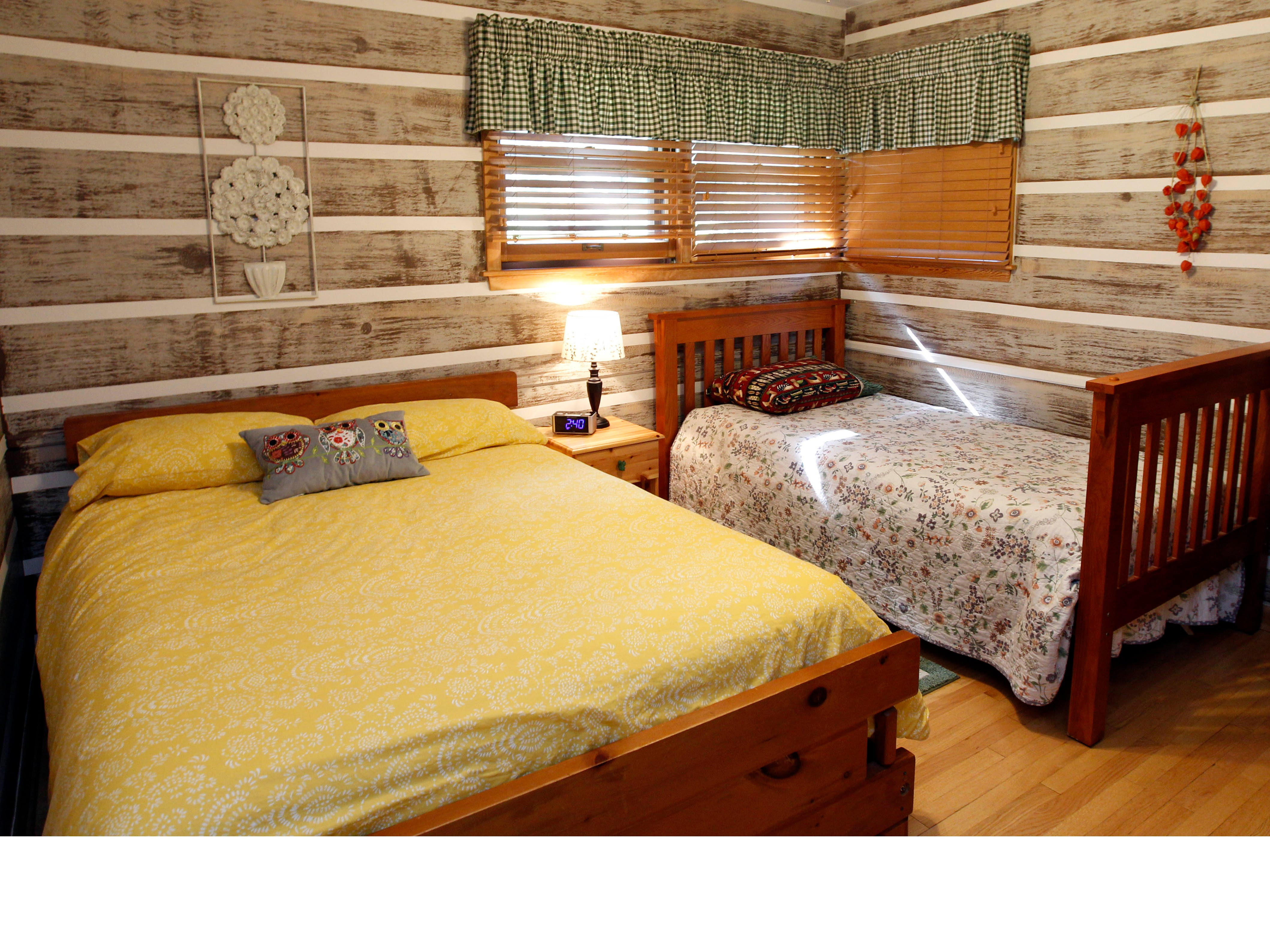 The log cabin look in this bedroom was created with several layers of paint.