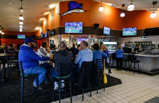 Customers enjoy a delicious Friday fish fry with beverages at Rocky's Hops & Leisure during the soft reopening of the Oconomowoc business on Friday, Oct. 5.