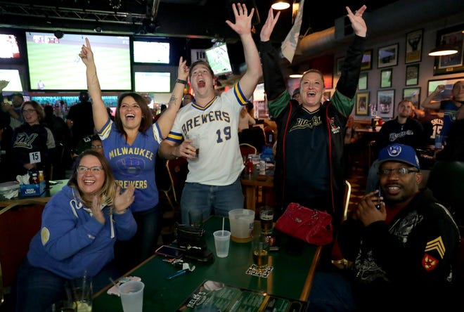 Brewers fans (from left), Katie Grenz of Greendale, Jennifer Wallis of Greenfield, Rick Hammerer of Wauwatosa, Melissa McCarty of Milwaukee, and Ron Stewart of Milwaukee cheer the final out at Kelly's Bleachers on West Bluemound Road, in Milwaukee as the Milwaukee Brewers beat the Colorado Rockies 6-0 in Denver to advance to the National League Championship Series, on Sunday.