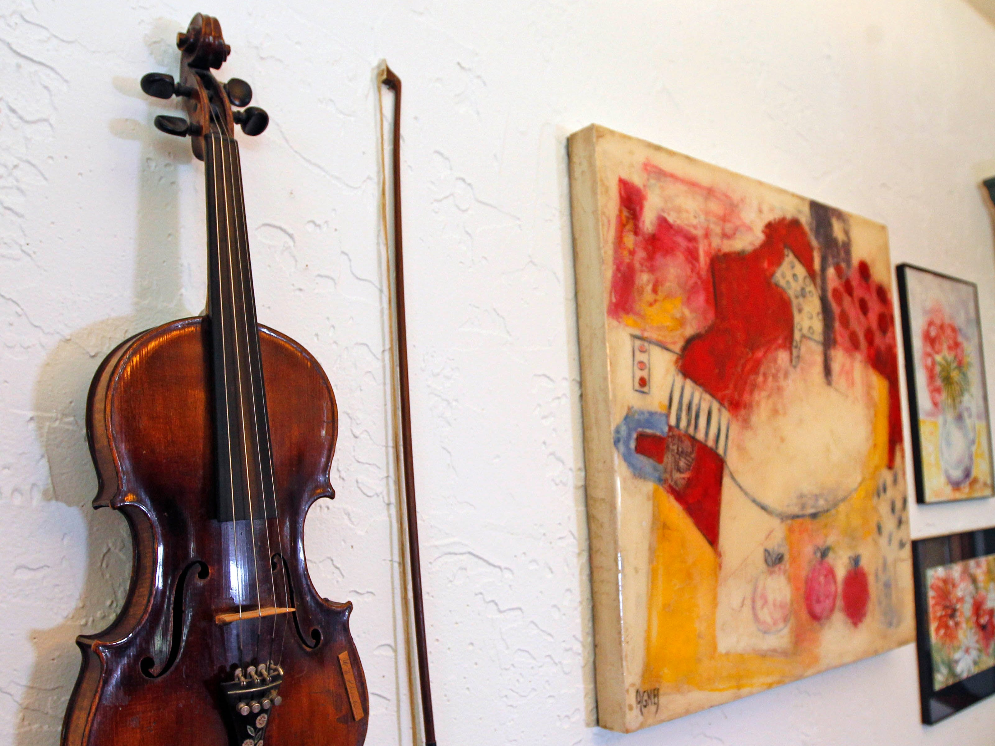 This fiddle belonged to Ann Sheahan's Irish grandfather and dates to about 1919. It's displayed in her dining room.