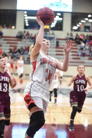 Norfork's Kinley Stowers goes up for two during the state quarterfinals against Alpena last season.