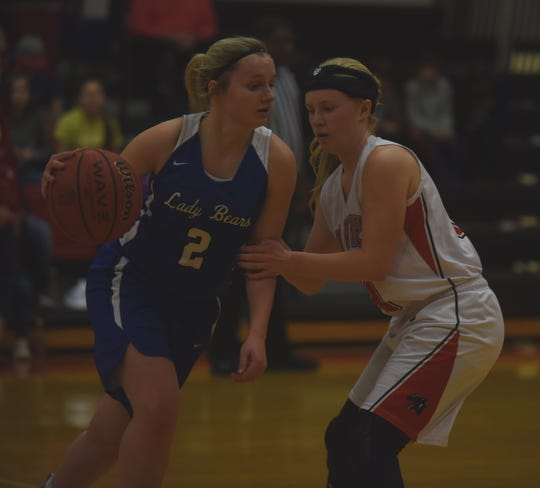 Norfork's Kinley Stowers guards Mammoth Spring's Whitlee Layne during a game last season.