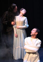 """Count Dracula (played by Marc LeVasseur, left) casts a spell on Mina Harker (Emaline Williams), while Renfield (Gary Littman) looks on.  """"Dracula,"""" Charles Morey's faithful adaptation of Bram Stoker's novel, runs at Centenary Stage Co. in Hackettstown from October 12 through 28."""