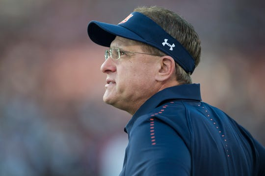 Auburn head coach Gus Malzahn watches his team warm up before they take on Mississippi State at Davis Wade Stadium in Starkville, Miss., on Saturday, Oct. 6, 2018. Mississippi State defeated Auburn 23-9.