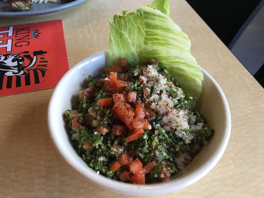 Tabouli salad featuring chopped parsley with bulgur wheat, olive oil, lemon and spices is served at King Tut Cafe.
