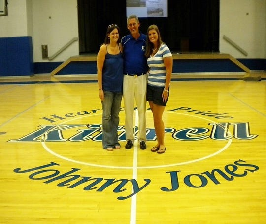 Former Kittrell coach and teacher Johnny Jones is shown with daughter Amy Jones, left, and niece Jenifer Jones Burns on the floor that was named in his honor. The longtime coach died over the weekend.
