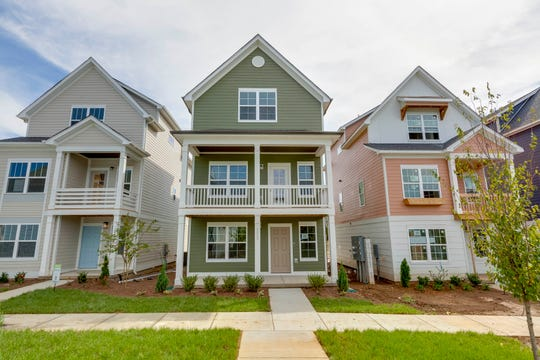 Waterford Village is designed with front porches and sidewalks to encourage getting to know the neighbors.