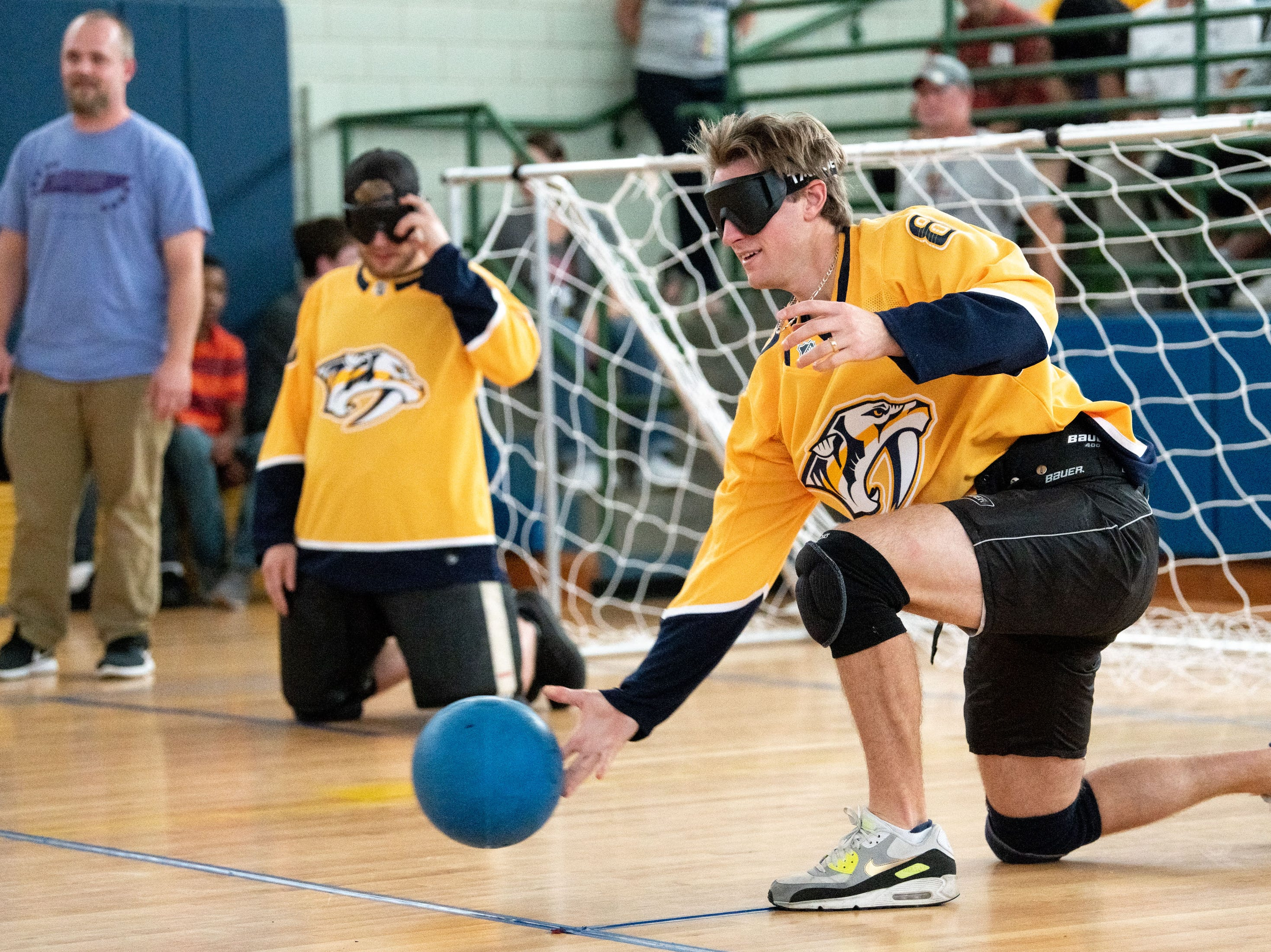 Nashville Predators forward Kyle Turris (8) throws during a game of goalball at the Tennessee School for the Blind in Nashville, Tenn., Monday, Oct. 8, 2018. Goalball is a sport designed specifically for athletes with vision impairment.