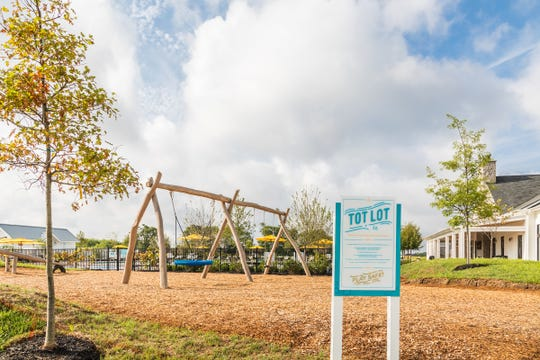 The tot lot at Durham Farms is a place where youngsters can play while their parents chat.