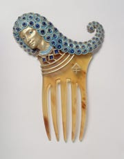 """Eugne-Samuel Grasset (1845–1917), Paul Vever (1851–1915), and Henri Vever (1854–1942). """"Assyrian"""" comb, 1900. Horn, repoussé gold, cloisonné enamel, and sapphires, 5 7/8 x 3 7/8 x 3/8 in. Petit Palais."""