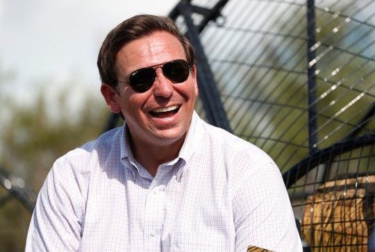 In this Sept. 12, 2018, file photo, Republican candidate for Florida Governor Ron DeSantis smiles during an airboat tour of the Florida Everglades, in Fort Lauderdale.