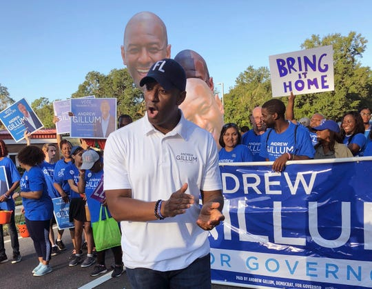 In this Oct. 6, 2018, file photo, Florida Democratic nominee for governor Andrew Gillum participates in the Florida A&M University homecoming parade in Tallahassee.