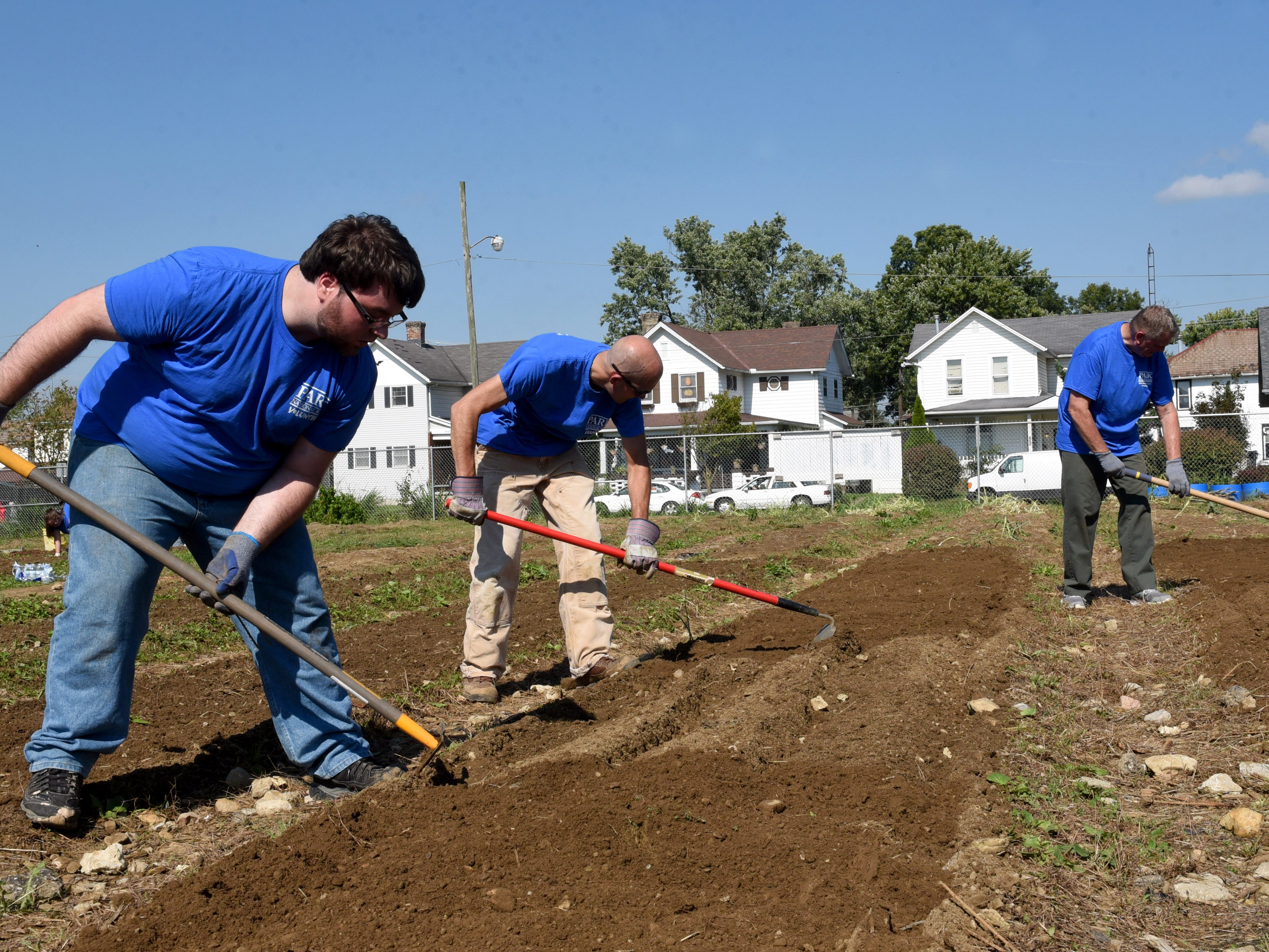 Park National Bank employees Ryan Blauser, David Trautman, and Phil West till the ground at the Together We Grow Garden on East Main Street in Newark. Bank employees volunteered at the garden to prepare it for winter as part of the company's PNB Cares initiative on Monday, Oct. 8, 2018. Employees worked on over 70 projects for organizations in Central Ohio communities. Local projects also included landscaping at the Weathervane Playhouse, organizing books for the Licking County Library, and painting for the Licking County Coalition for Housing.
