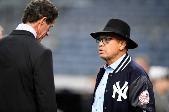Former New York Yankees Reggie Jackson, right, and Paul O'Neill talk during batting practice before Game 3 of the American League Division Series on Monday, Oct. 8, 2018, in New York.
