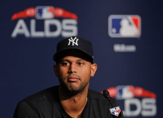 New York Yankees center fielder Aaron Hicks answers questions during a news conference, Sunday, Oct. 7, 2018, in New York. The Yankees will play against the Boston Red Sox in Game 3 of the AL Division Series on Monday.