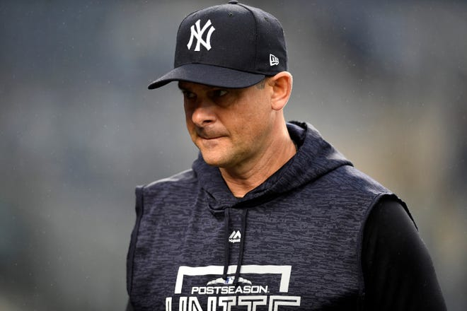 New York Yankees manager Aaron Boone on the field during batting practice before Game 3 of the American League Division Series on Monday, Oct. 8, 2018, in New York.