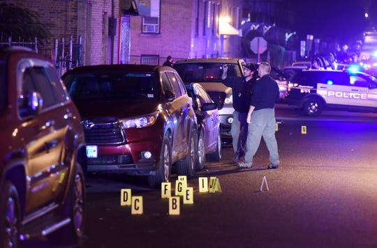 Police at the scene where a person was shot on E26th Street at Tenth Avenue in Paterson, NJ around 3:30 a.m. on October 7, 2018. (Photo/Christopher Sadowski)