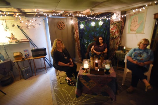 Coven members, from left, Colleen Trusler, Niki Somers and Michelle Sauer, discuss plans for their upcoming masquerade and dinner/dance in Paramus