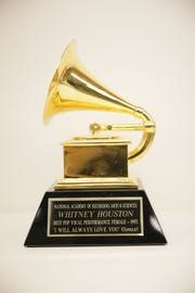 "Whitney Houston's 1993 Grammy award for her single, ""I Will Always Love You,"" is on display as part of the ""Whitney!"" exhibit at the Grammy Museum Experience Prudential Center in Newark."