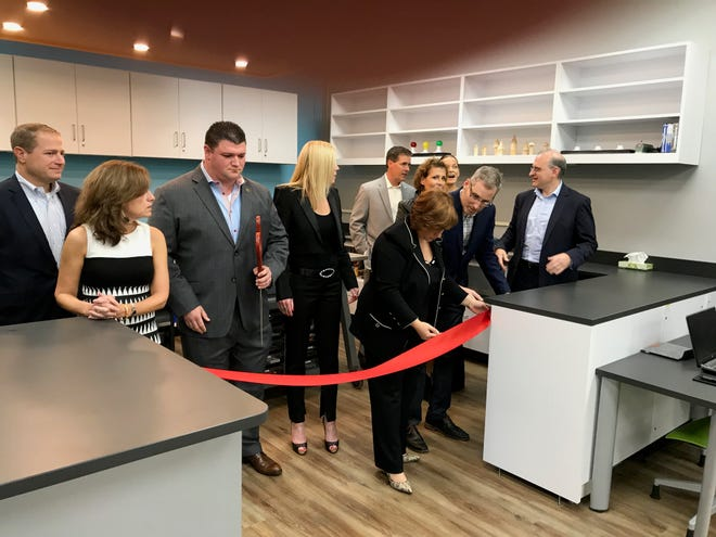 Monday's ribbon cutting for Little Falls School STEAM Lab included local officials as well as Susan St. Ledger, who donated $60,000 for the lab.