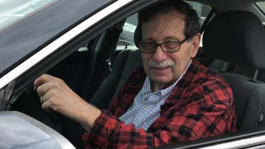 Jeffrey Page, who wrote The Road Warrior column from 1990 to 2003, shown last week behind the wheel of his Honda Civic.