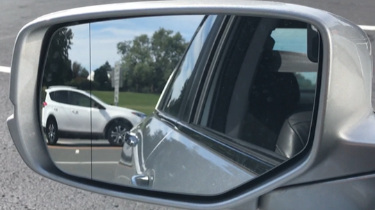 Blind spots can virtually be eliminated by properly adjusting your side rear-view mirror.