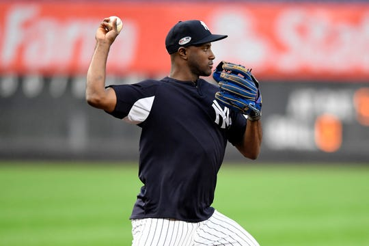 New York Yankees' Adeiny Hechavarria warms up before Game 3 of the American League Division Series on Monday, Oct. 8, 2018, in New York.