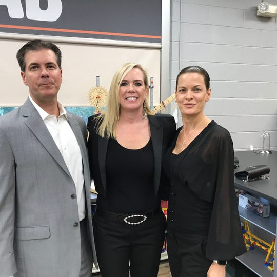 Susan St. Ledger, who donated $60,000 to Little Falls School for a STEAM Lab, is flanked by her brother David and sister-in-law, Danielle.