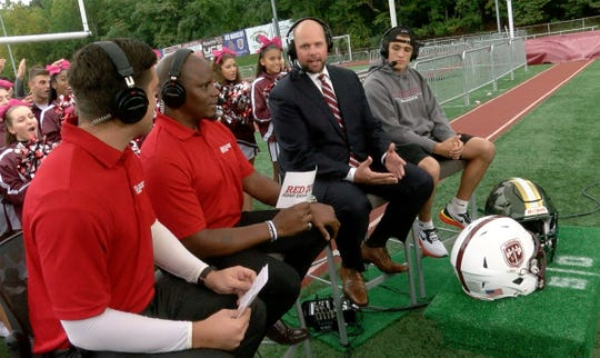 Don Bosco coach Mike Teel and wide receiver Christian Dremel are shown during the taping of the the Red Zone Road Show shot at Don Bosco Prep Monday October 8, 2018.  Hosts Ryan Ross (left) and Chris Melvin are at left.