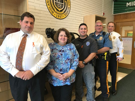 Midland Park School Resource Officer Jason Tillson (center), with Principal Nicholas Capuano, Superintendent of Schools Dr. Marie Cirasella, Lt. Greg Kasbarian, and Chief Michael Powderley.