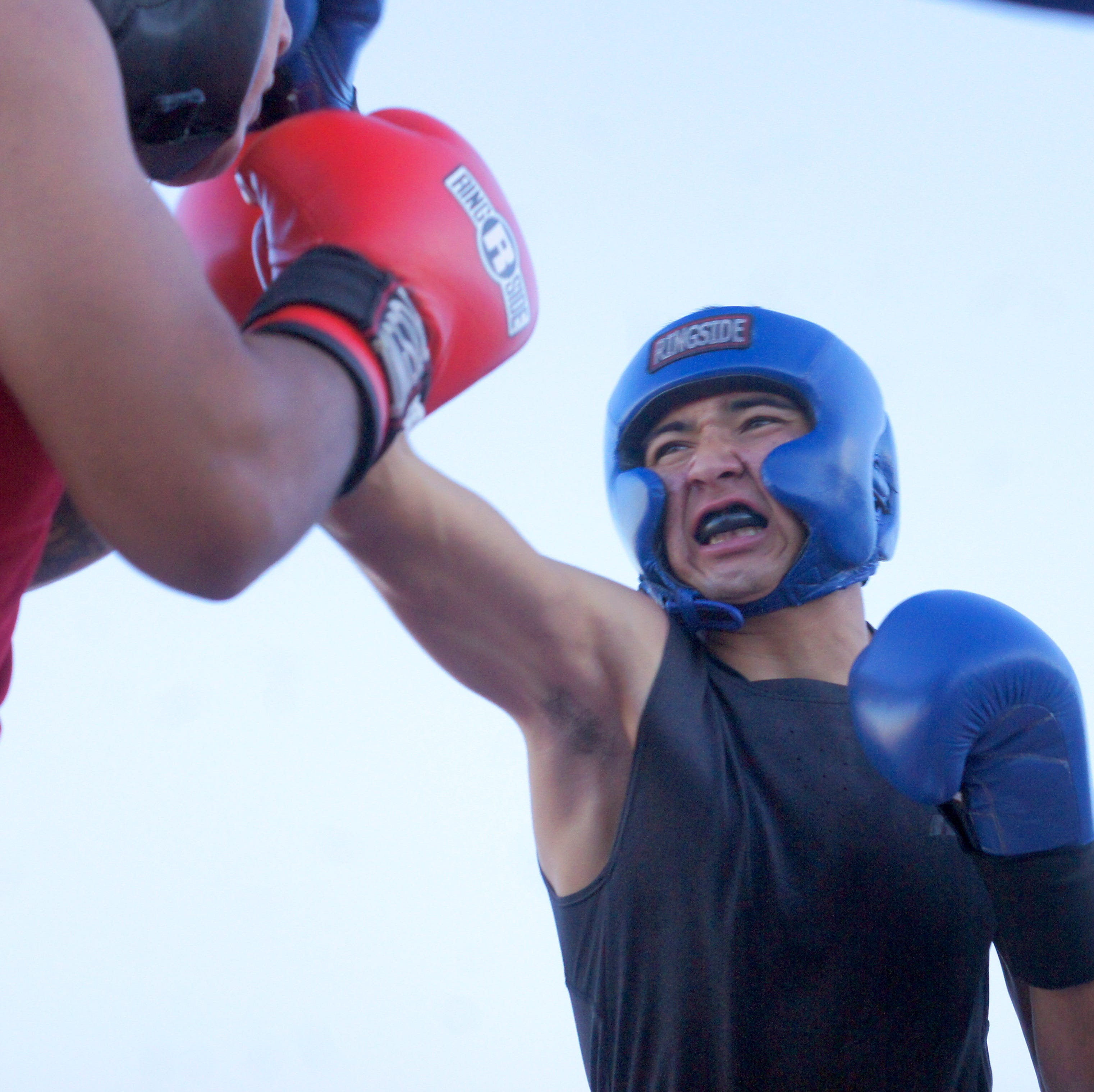 Christian Lopez, right, scored a unanimous decision and registered two standing eight counts in his amateur boxing debut at the Fairground Throw-Down boxing event on Saturday at the Southwestern New Mexico State Fair in Deming, NM.
