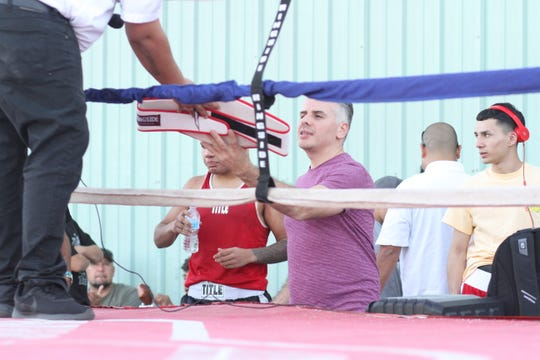 """Ringside physician Dr. Victor Cruz was presented an honorary title belt for his volunteer work as the """"Fight Doctor"""" for local Superior Boxing Club tournaments."""