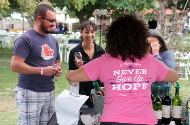 Shirts worn by St. Clair Winery staff during the Fall Harvest Wine Festival made a clear statement for those living and/or touched by breast cancer. The month of October was National Breast Cancer Awareness Month.
