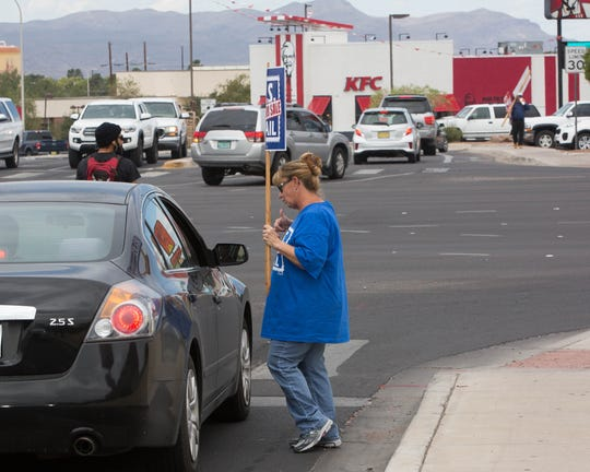 Rebecca Russell, a rural mail carrier with the US Postal Service, talks to occupants of a vehicle stopped at the intersection of Telshor Boulevard and Lohman Drive during an American Postal Workers Union protest, The APWU Local 402 was protesting the possibility of the USPS becoming privatized.