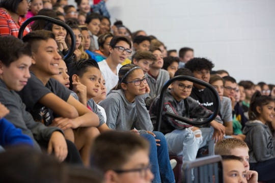 "Students at Sierra Middle School listen to RJ Mitte, an actor best known for his work on the show ""Breaking Bad,"" as he delivered an anti-bullying message to the students, Monday Oct. 8, 2018."