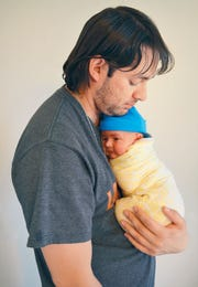 Matthew Thomas, Transwestern Pipeline technician and station operator , with baby Alastair.