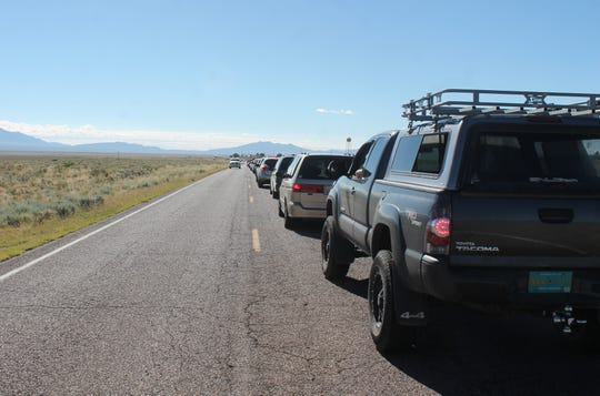 Vehicles line up for miles outside the checkpoint to get in to see Trinity Site at the White Sands Missile Range.