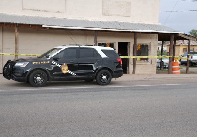 New Mexico State Police Investigations Bureau agents investigating a homicide at 307 St. Francis Drive in Tularosa Saturday.
