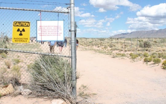 Signs at the Trinity Site warn visitors of the presence of radioactive materials and against taking photos of any other part of the White Sands Missile Range.