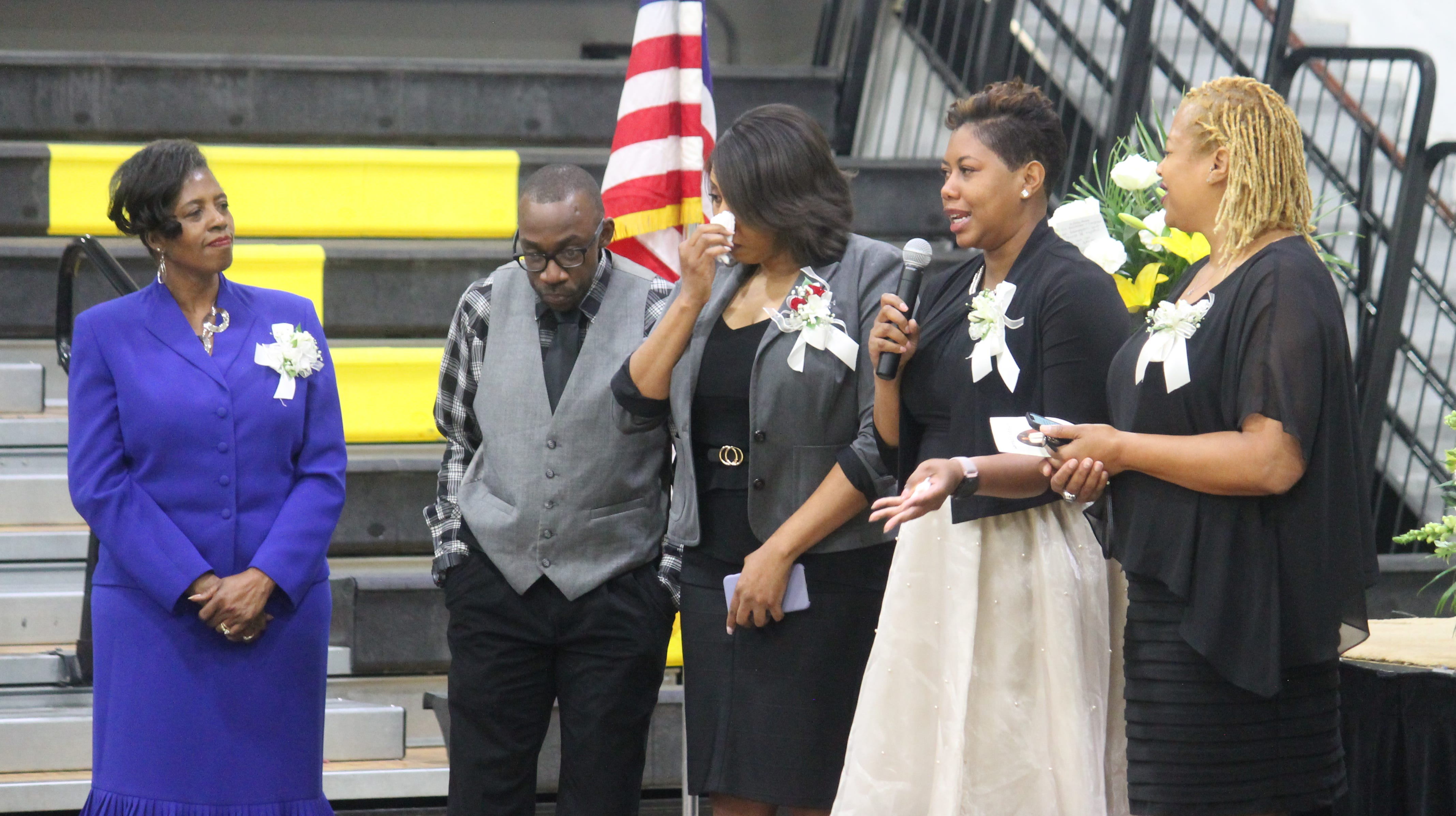 Hundreds of people gathered at Alamogordo High School on Monday to say goodbye to former AHS athletic director Lawrence Johnson, including, from L-R, his sister Regina Wright, nephew Trevon Johnson, and daughters Erika Johnson, Aisha Thomas, and Carla Johnson.