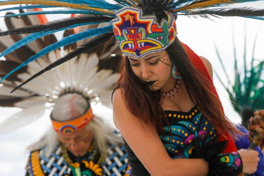 At center, Crystal Zamora performs with the Ehecatl Aztec Dancers Monday during Indigenous Peoples Day at San Juan College in Farmington.