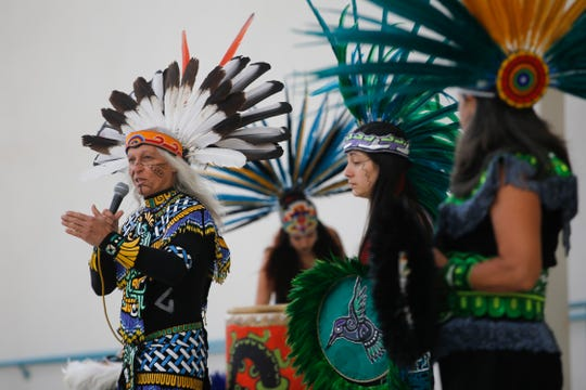 At left, Mapitzmitl Xiukwetzpallin talks during a performance, Monday, Oct. 8, 2018 during Indigenous Peoples Day at San Juan College in Farmington.