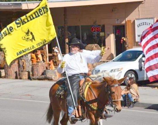 A member of the Mule Skinners from Amarillo, Texas rode in the parade on a not so happy mule.