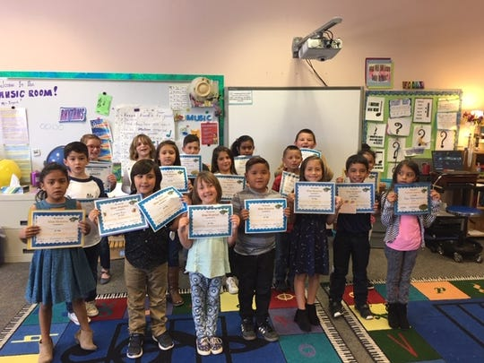 Happy 'Wee Warriors' with their awards for being exceptional students at Sierra Vista Primary School.