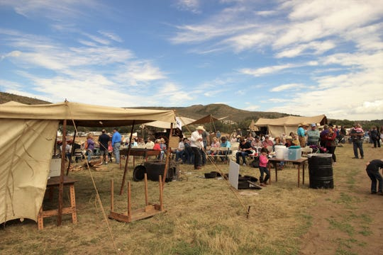 Visitors at the 2017 Lincoln County Cowboy Symposium enjoy the tasty-treats prepared by the chuckwagon's cooks.