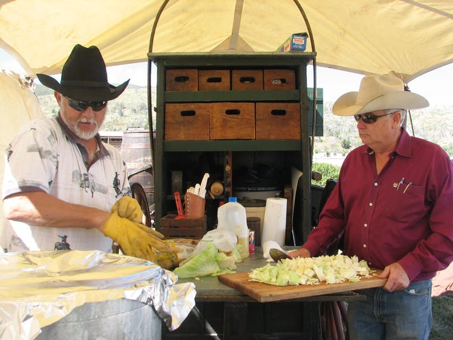 Chuckwagon chefs prepare to dazzle visitors with their menu at the Lincoln County Cowboy Symposium.