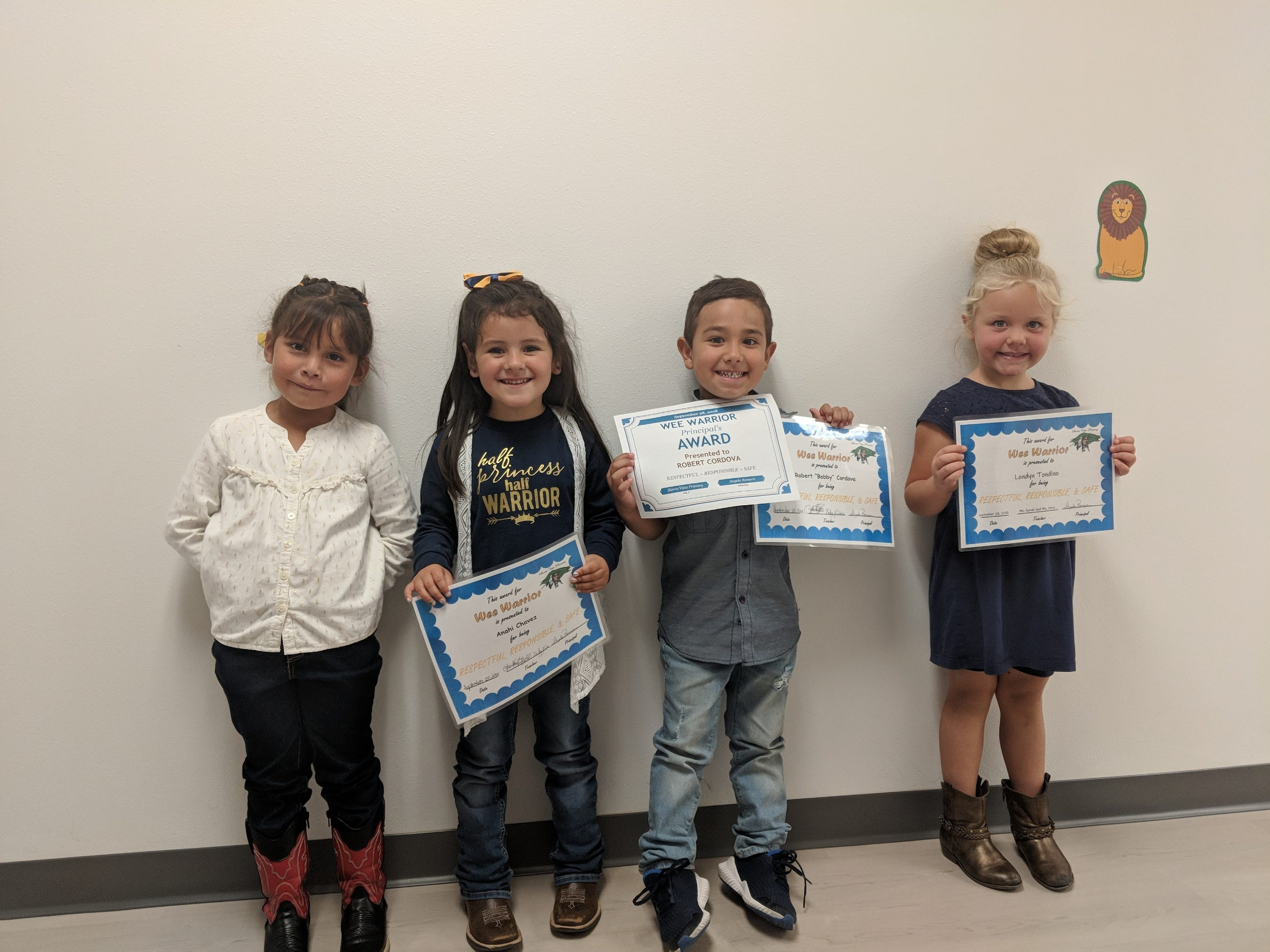 Students receive awards at Sierra Vista Primary for being exceptional students.